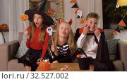 Купить «kids in halloween costumes having fun at home», видеоролик № 32527002, снято 14 ноября 2019 г. (c) Syda Productions / Фотобанк Лори