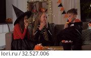 Купить «kids in halloween costumes playing at home», видеоролик № 32527006, снято 14 ноября 2019 г. (c) Syda Productions / Фотобанк Лори