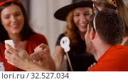 Купить «friends in halloween costumes with smartphone», видеоролик № 32527034, снято 18 ноября 2019 г. (c) Syda Productions / Фотобанк Лори