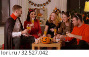 happy friends in halloween costumes at home party. Стоковое видео, видеограф Syda Productions / Фотобанк Лори