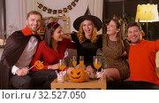 Купить «happy friends in halloween costumes at home party», видеоролик № 32527050, снято 18 ноября 2019 г. (c) Syda Productions / Фотобанк Лори