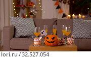 Купить «halloween decorations and treats on table at home», видеоролик № 32527054, снято 18 ноября 2019 г. (c) Syda Productions / Фотобанк Лори