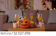 Купить «halloween decorations and treats on table at home», видеоролик № 32527058, снято 18 ноября 2019 г. (c) Syda Productions / Фотобанк Лори