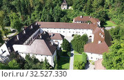 Купить «Panoramic view from drone of the Bistra castle in Vrhnika. Slovenia», видеоролик № 32527330, снято 4 сентября 2019 г. (c) Яков Филимонов / Фотобанк Лори
