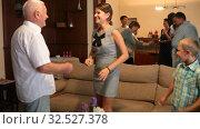 Купить «Adults and children dancing at a party at home», видеоролик № 32527378, снято 17 августа 2019 г. (c) Яков Филимонов / Фотобанк Лори