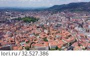 Купить «Aerial view of Oviedo city with buildings and lanscape, Asturias, Spain», видеоролик № 32527386, снято 15 июля 2019 г. (c) Яков Филимонов / Фотобанк Лори