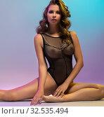 Купить «Erotica. Graceful woman dressed in sexy bodysuit», фото № 32535494, снято 2 сентября 2016 г. (c) Гурьянов Андрей / Фотобанк Лори