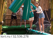 Купить «Obstacle course over the water - fun adventure in an amusement park», фото № 32536278, снято 8 июля 2020 г. (c) Яков Филимонов / Фотобанк Лори