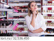 Купить «thoughtful stylish girl in cosmetics store», фото № 32536450, снято 31 января 2018 г. (c) Яков Филимонов / Фотобанк Лори