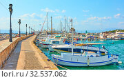 Купить «Pier with moored fishing boats in the port of Aegina town», фото № 32537062, снято 13 сентября 2019 г. (c) Роман Сигаев / Фотобанк Лори