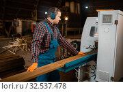Woodworker works on machine, lumber industry. Стоковое фото, фотограф Tryapitsyn Sergiy / Фотобанк Лори