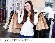 Купить «girl purchaser with packs delighted from purchases», фото № 32538334, снято 17 января 2018 г. (c) Яков Филимонов / Фотобанк Лори