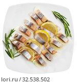 Купить «Marinated herring with sliced onion and lemon», фото № 32538502, снято 9 декабря 2019 г. (c) Яков Филимонов / Фотобанк Лори