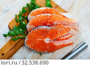 Купить «Raw salmon fillet on wooden table», фото № 32538690, снято 5 декабря 2019 г. (c) Яков Филимонов / Фотобанк Лори