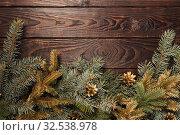 Купить «Christmas fir branches on old dark wooden background», фото № 32538978, снято 14 ноября 2019 г. (c) Майя Крученкова / Фотобанк Лори