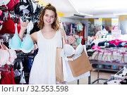 Купить «Girl selecting underwear», фото № 32553598, снято 19 июня 2017 г. (c) Яков Филимонов / Фотобанк Лори