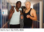 Купить «Two athletes in the locker room after training», фото № 32555466, снято 28 января 2019 г. (c) Яков Филимонов / Фотобанк Лори