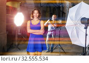 Купить «Young attractive woman delighted with professional photo shootin», фото № 32555534, снято 5 октября 2018 г. (c) Яков Филимонов / Фотобанк Лори
