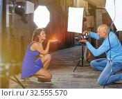 Купить «Professional photo shooting outdoors. Attractive female model po», фото № 32555570, снято 5 октября 2018 г. (c) Яков Филимонов / Фотобанк Лори