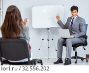 Купить «The business presentation in the office with man and woman», фото № 32556202, снято 7 августа 2017 г. (c) Elnur / Фотобанк Лори