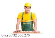 Купить «The handsome construction worker building brick wall», фото № 32556270, снято 5 ноября 2016 г. (c) Elnur / Фотобанк Лори