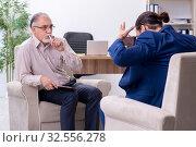 Купить «Young man visiting old male doctor psychologist», фото № 32556278, снято 22 августа 2019 г. (c) Elnur / Фотобанк Лори