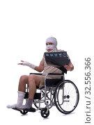 Купить «Injured man in wheel-chair isolated on white», фото № 32556366, снято 17 мая 2019 г. (c) Elnur / Фотобанк Лори