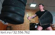 Купить «Knights training - a tattooed man training his sword fighting skills on the bunch of tires», видеоролик № 32556762, снято 27 мая 2020 г. (c) Константин Шишкин / Фотобанк Лори