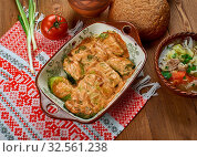 Купить «Galumpkis, Stuffed Cabbage Rolls, Polish cuisine , Traditional assorted Poland dishes, Top view.», фото № 32561238, снято 18 февраля 2020 г. (c) easy Fotostock / Фотобанк Лори