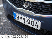 Купить «Finnish licence plate is on rear of Kia car. It is European type plate with blue sign of EU and FIN inscription on side of shield», фото № 32563150, снято 30 октября 2019 г. (c) Кекяляйнен Андрей / Фотобанк Лори