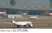 Купить «Airplane departure from International Airport, Hong Kong», видеоролик № 32570886, снято 10 ноября 2019 г. (c) Игорь Жоров / Фотобанк Лори