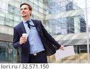 Купить «man with documents hurrying to meeting», фото № 32571150, снято 29 апреля 2017 г. (c) Яков Филимонов / Фотобанк Лори