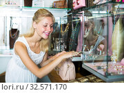 Купить «Glad young woman looking fashion bijouterie», фото № 32571170, снято 5 декабря 2019 г. (c) Яков Филимонов / Фотобанк Лори