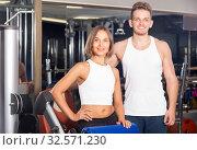 Купить «Portrait of couple standing together in gym indoors», фото № 32571230, снято 4 октября 2016 г. (c) Яков Филимонов / Фотобанк Лори