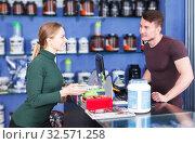 Купить «Girl buying sport food supplements», фото № 32571258, снято 12 апреля 2018 г. (c) Яков Филимонов / Фотобанк Лори