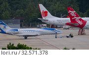 Купить «Private airplane towing in Phuket airport», видеоролик № 32571378, снято 27 ноября 2019 г. (c) Игорь Жоров / Фотобанк Лори