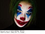 Купить «Clown make-up with green hair for Halloween. Close-up face on black background.», фото № 32571722, снято 21 октября 2019 г. (c) Женя Канашкин / Фотобанк Лори