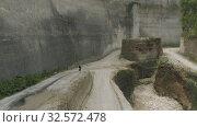 Купить «Bike on the road in Mountains Uluwatu Bali beach and rocks», видеоролик № 32572478, снято 29 октября 2019 г. (c) Aleksejs Bergmanis / Фотобанк Лори