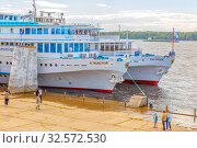 "Купить «Russia, Samara, June 2017: Motor ships ""Alexey Tolstoy"" and ""A.I.Gerzen"" on the pier. in a summer sunny day. Text in Russian: Tolstoy, Herzen.», фото № 32572530, снято 23 июня 2017 г. (c) Акиньшин Владимир / Фотобанк Лори"