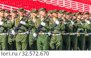 Купить «Russia, Samara, May 2016: The construction of soldiers with rifles for Victory Day at the rehearsal of the parade on Kuibyshev Square on a spring sunny day.», фото № 32572670, снято 7 мая 2017 г. (c) Акиньшин Владимир / Фотобанк Лори