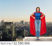 Купить «happy woman in red superhero cape over tokyo city», фото № 32580966, снято 30 сентября 2019 г. (c) Syda Productions / Фотобанк Лори