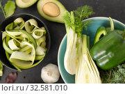 Купить «close up of different green vegetables», фото № 32581010, снято 12 апреля 2018 г. (c) Syda Productions / Фотобанк Лори