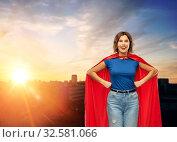 Купить «happy woman in red superhero cape over city sunset», фото № 32581066, снято 30 сентября 2019 г. (c) Syda Productions / Фотобанк Лори