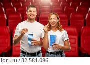 Купить «happy couple eating popcorn at movie theatre», фото № 32581086, снято 6 октября 2019 г. (c) Syda Productions / Фотобанк Лори