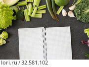 Купить «green vegetables and diary with empty pages», фото № 32581102, снято 12 апреля 2018 г. (c) Syda Productions / Фотобанк Лори