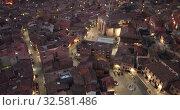 Купить «Evening aerial view of medieval Spanish town of Daroca with illuminated Basilica of St. Mary of Sacred Body», видеоролик № 32581486, снято 9 марта 2019 г. (c) Яков Филимонов / Фотобанк Лори