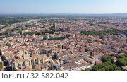 Купить «Scenic panoramic aerial view of residential areas of Narbonne with medieval Roman Catholic Cathedral on sunny summer day, France», видеоролик № 32582042, снято 30 августа 2019 г. (c) Яков Филимонов / Фотобанк Лори