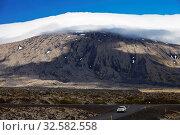 Купить «Der Vulkan und Gletscher Snæfellsjoekull mit Wolken, Halbinsel Snæfellsnes, Westisland, Vesturland, Island, Europa», фото № 32582558, снято 17 января 2020 г. (c) age Fotostock / Фотобанк Лори
