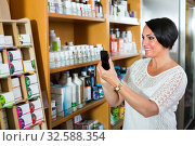 Купить «mature woman with phone in drugstore», фото № 32588354, снято 6 апреля 2020 г. (c) Яков Филимонов / Фотобанк Лори