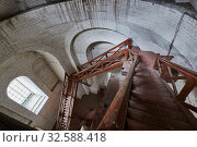 Купить «Long decrepit wooden staircase inside a church tower», фото № 32588418, снято 23 октября 2017 г. (c) Олег Белов / Фотобанк Лори